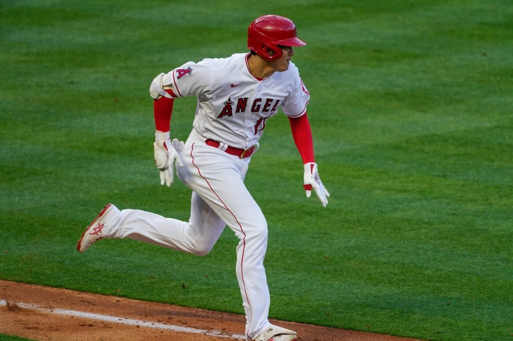 May 19, 2021; Anaheim, California, USA; Los Angeles Angels right fielder Shohei Ohtani (17) sprints to first base on a bunt for a hit in the fifth inning against the Cleveland Indians at Angel Stadium. Mandatory Credit: Robert Hanashiro-USA TODAY Sports