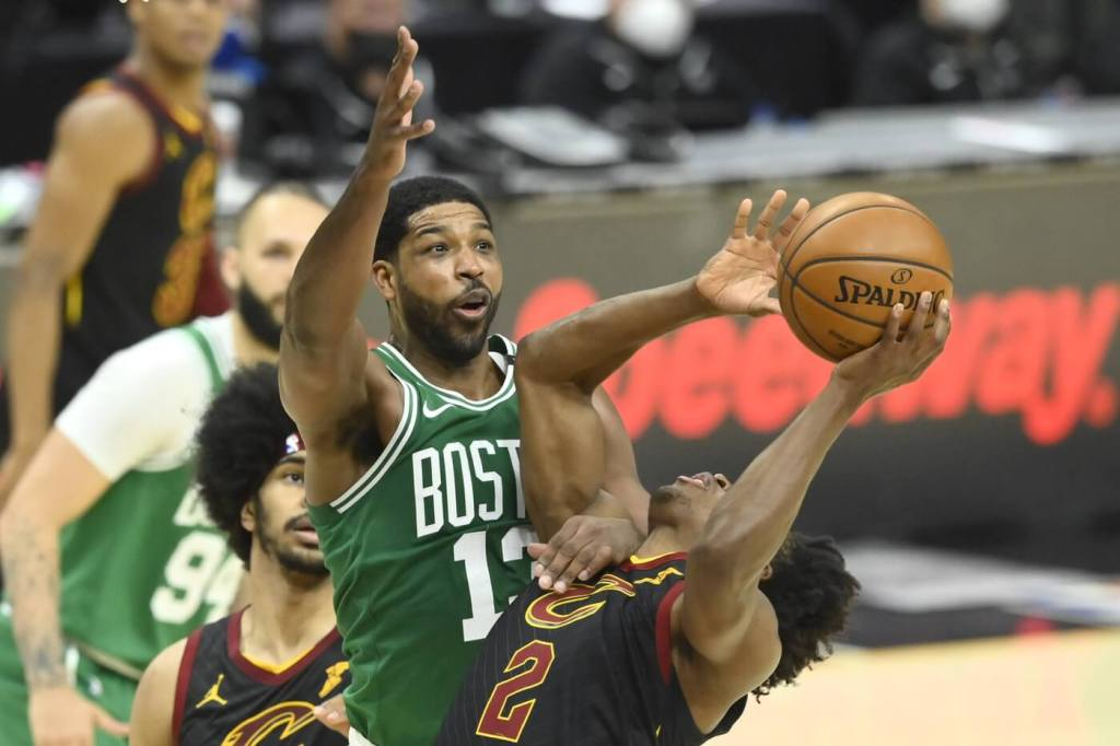 May 12, 2021; Cleveland, Ohio, USA; Boston Celtics center Tristan Thompson (13) defends Cleveland Cavaliers guard Collin Sexton (2) in the third quarter at Rocket Mortgage FieldHouse. Mandatory Credit: David Richard-USA TODAY Sports