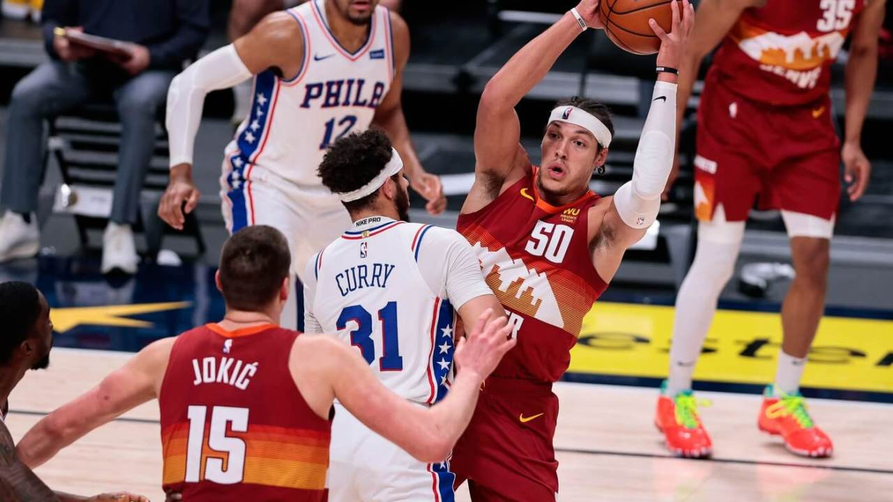 Mar 30, 2021; Denver, Colorado, USA; Denver Nuggets forward Aaron Gordon (50) corns the ball against Philadelphia 76ers guard Seth Curry (31) in the second quarter at Ball Arena. Mandatory Credit: Isaiah J. Downing-USA TODAY Sports