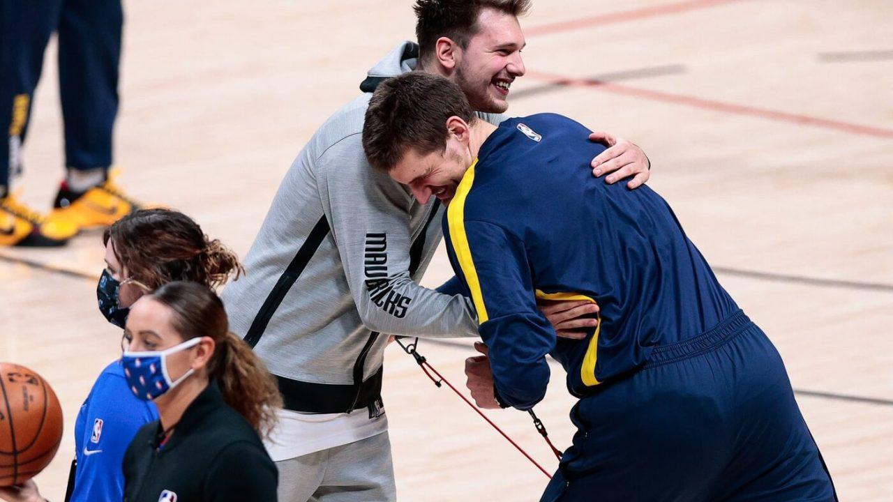 Jan 7, 2021; Denver, Colorado, USA; Dallas Mavericks guard Luka Doncic (77) greets Denver Nuggets center Nikola Jokic (15) before the game at Ball Arena. Mandatory Credit: Isaiah J. Downing-USA TODAY Sports