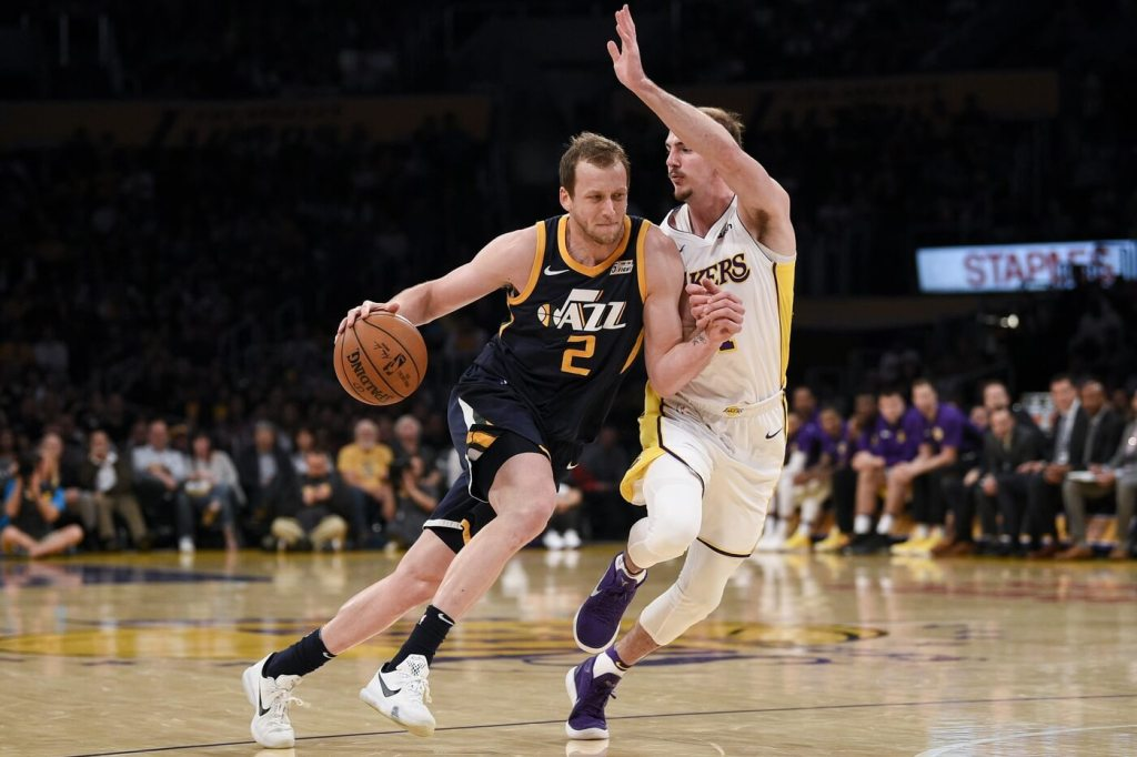 Apr 8, 2018; Los Angeles, CA, USA; Utah Jazz forward Joe Ingles (2) attempts to move past Los Angeles Lakers guard Alex Caruso (4) during the second half at Staples Center. Mandatory Credit: Kelvin Kuo-USA TODAY Sports