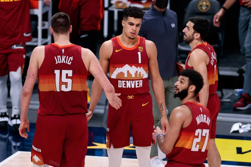 Mar 30, 2021; Denver, Colorado, USA; Denver Nuggets forward Michael Porter Jr. (1) reacts with center Nikola Jokic (15) and guard Facundo Campazzo (7) during a timeout in the fourth quarter against the Philadelphia 76ers at Ball Arena. Mandatory Credit: Isaiah J. Downing-USA TODAY Sports