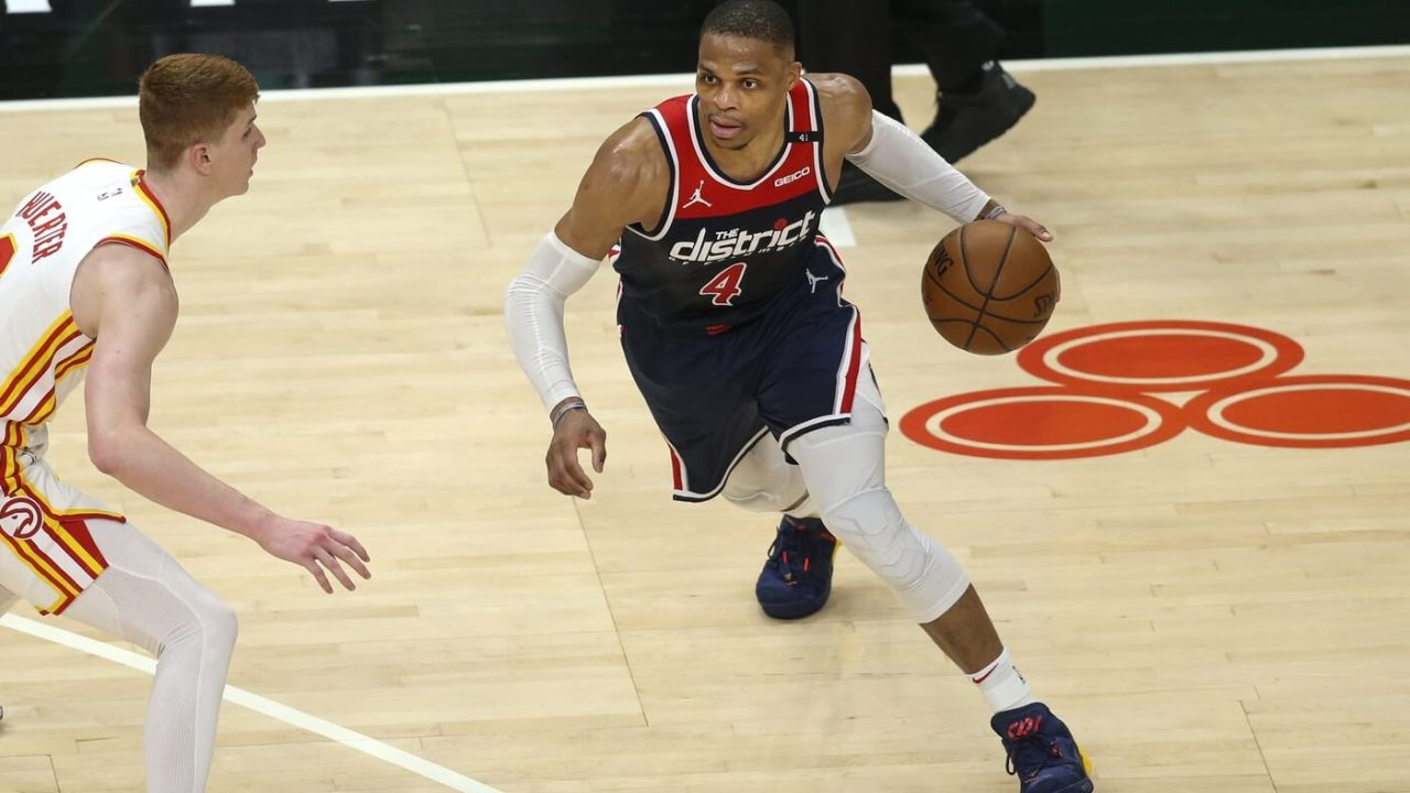 May 10, 2021; Atlanta, Georgia, USA; Washington Wizards guard Russell Westbrook (4) is defended by Atlanta Hawks guard Kevin Huerter (3) in the fourth quarter at State Farm Arena. Mandatory Credit: Brett Davis-USA TODAY Sports