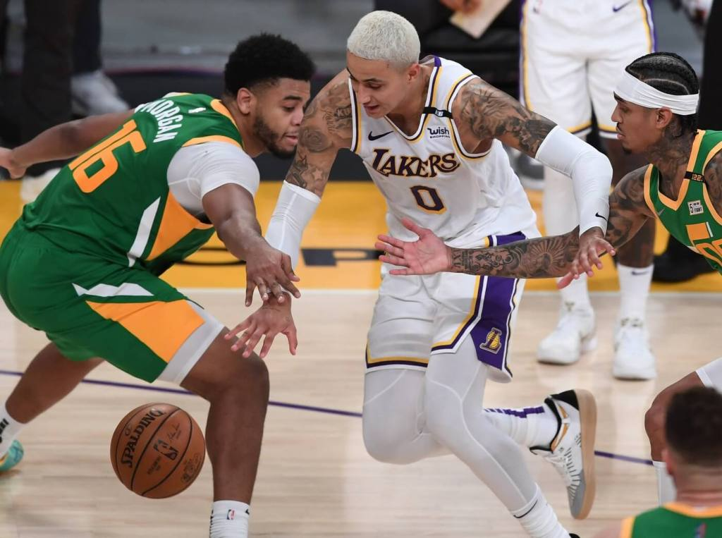 Apr 17, 2021; Los Angeles, California, USA; Utah Jazz forward Juwan Morgan (16) and guard Jordan Clarkson (00) defend Los Angeles Lakers forward Kyle Kuzma (0) as he drives to the basket in the second half of the game at Staples Center. Mandatory Credit: Jayne Kamin-Oncea-USA TODAY Sports