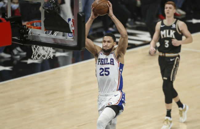 Jun 14, 2021; Atlanta, Georgia, USA; Philadelphia 76ers guard Ben Simmons (25) dunks against the Atlanta Hawks in the first quarter during game four in the second round of the 2021 NBA Playoffs at State Farm Arena. Mandatory Credit: Brett Davis-USA TODAY Sports