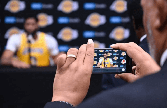 Sep 27, 2019; Los Angeles, CA, USA; Los Angeles Lakers forward/center Anthony Davis is recorded on a reporters mobile phone as Davis answers a question during the Los Angeles Lakers media day at the UCLA Health Training Center in El Segundo, CA. Mandatory Credit: Robert Hanashiro-USA TODAY Sports