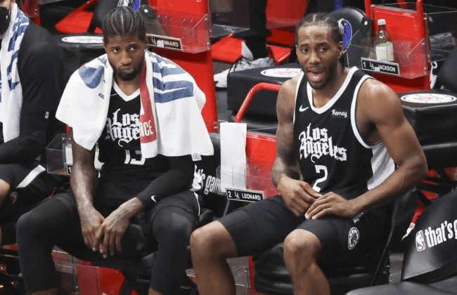 May 30, 2021; Dallas, Texas, USA; LA Clippers forward Kawhi Leonard (2) and LA Clippers guard Paul George (13) react during the fourth quarter against the Dallas Mavericks in game four in the first round of the 2021 NBA Playoffs at American Airlines Center. Mandatory Credit: Kevin Jairaj-USA TODAY Sports