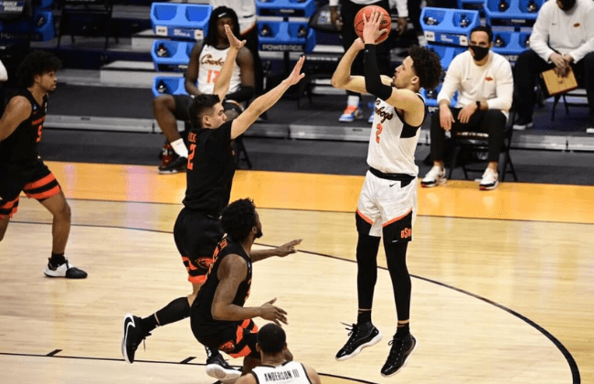 Oklahoma State Cowboys guard Cade Cunningham (2) shoots while Oregon State Beavers guard Jarod Lucas (2) defends during the second half in the second round of the 2021 NCAA Tournament at Hinkle Fieldhouse.