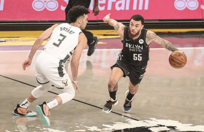 Jun 7, 2021; Brooklyn, New York, USA; Brooklyn Nets guard Mike James (55) drives past Milwaukee Bucks guard Elijah Bryant (3) in the fourth quarter during game two in the second round of the 2021 NBA Playoffs. at Barclays Center. Mandatory Credit: Wendell Cruz-USA TODAY Sports