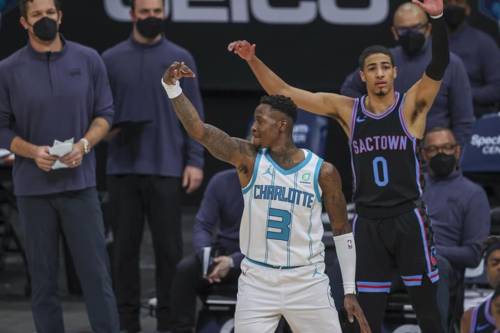 Mar 15, 2021; Charlotte, North Carolina, USA; Charlotte Hornets guard Terry Rozier (3) reacts after hitting a clutch three-pointer in front of Sacramento Kings guard Tyrese Haliburton (0) during the fourth quarter at Spectrum Center. The Charlotte Hornets won 122-116. Mandatory Credit: Nell Redmond-USA TODAY Sports
