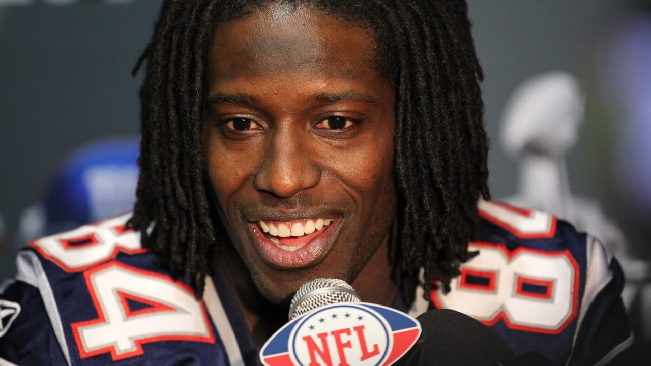 Feb 2, 2012; Indianapolis, IN, USA; New England Patriots receiver Deion Branch (84) answers questions during a press conference in preparation for Super Bowl XLVI against the New York Giants at Lucas Oil Stadium. Mandatory Credit: Matthew Emmons-USA TODAY Sports