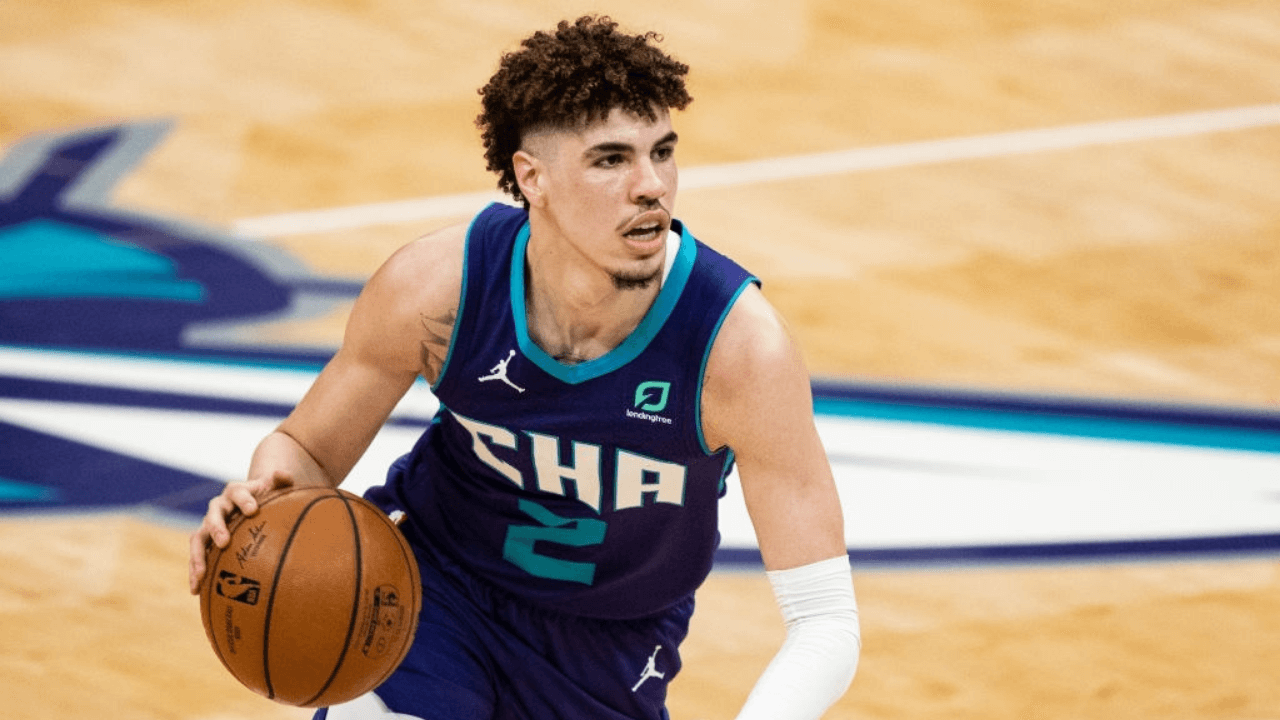 CHARLOTTE, NORTH CAROLINA - MAY 07: LaMelo Ball #2 of the Charlotte Hornets brings the ball up court against the Orlando Magic during their game at Spectrum Center on May 07, 2021 in Charlotte, North Carolina. NOTE TO USER: User expressly acknowledges and agrees that, by downloading and or using this photograph, User is consenting to the terms and conditions of the Getty Images License Agreement. (Photo by Jacob Kupferman/Getty Images)