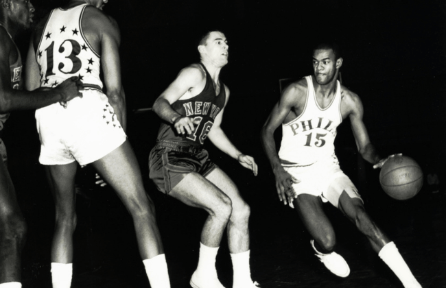 Unknown date; New York, NY, USA: FILE PHOTO; Philadelphia 76ers guard Hal Greer (15) in action as center Wilt Chamberlain (13) sets a pick against the New York Knicks. Greer was the first player to have his number retired by the 76ers.