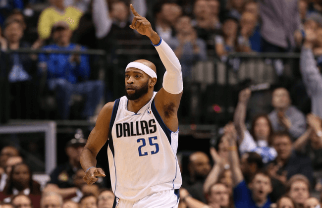Feb 20, 2013; Dallas, TX, USA; Dallas Mavericks guard Vince Carter (25) celebrates after a steal and an assist in the fourth quarter against the Orlando Magic at the American Airlines Center.