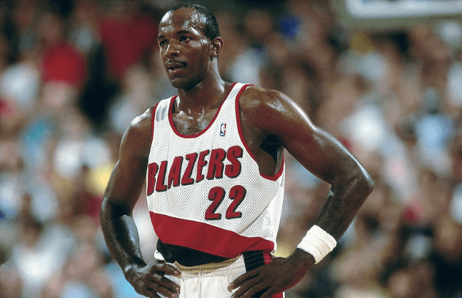 PORTLAND, OR - 1992: Clyde Drexler #22 of the Portland Trailblazers looks on during a game at the Veterans Memorial Coliseum in 1992 in Portland, Oregon. NOTE TO USER: User expressly acknowledges and agrees that, by downloading and or using this photograph, User is consenting to the terms and conditions of the Getty Images License Agreement. Mandatory Copyright Notice: Copyright 1992 NBAE (Photo by Brian Drake/NBAE via Getty Images)