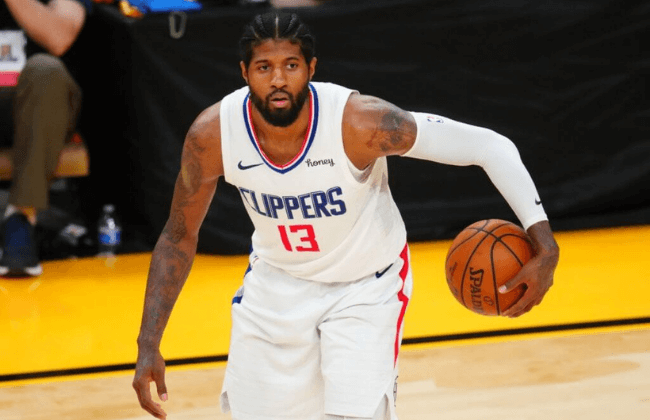 Jun 28, 2021; Phoenix, Arizona, USA; Los Angeles Clippers guard Paul George (13) against the Phoenix Suns in game five of the Western Conference Finals for the 2021 NBA Playoffs at Phoenix Suns Arena. Mandatory Credit: Mark J. Rebilas-USA TODAY Sports