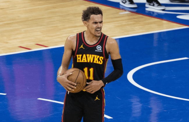 Jun 20, 2021; Philadelphia, Pennsylvania, USA; Atlanta Hawks guard Trae Young (11) reacts with fans in the closing seconds of a victory against the Philadelphia 76ers in game seven of the second round of the 2021 NBA Playoffs at Wells Fargo Center. Mandatory Credit: Bill Streicher-USA TODAY Sports