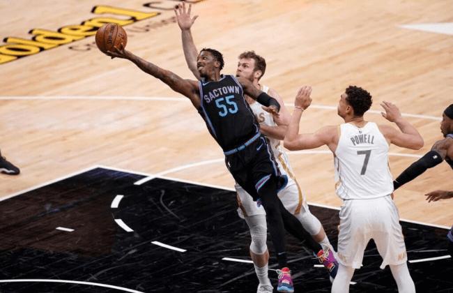 Apr 26, 2021; Sacramento, California, USA; Sacramento Kings guard Delon Wright (55) shoots the ball against the Dallas Mavericks in the fourth quarter at the Golden 1 Center. Mandatory Credit: Cary Edmondson-USA TODAY Sports