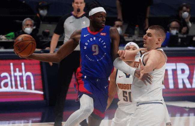Apr 6, 2021; Denver, Colorado, USA; Detroit Pistons forward Jerami Grant (9) prepares to pass the ball past Denver Nuggets center Nikola Jokic (15) in the third quarter at Ball Arena. Mandatory Credit: Ron Chenoy-USA TODAY Sports