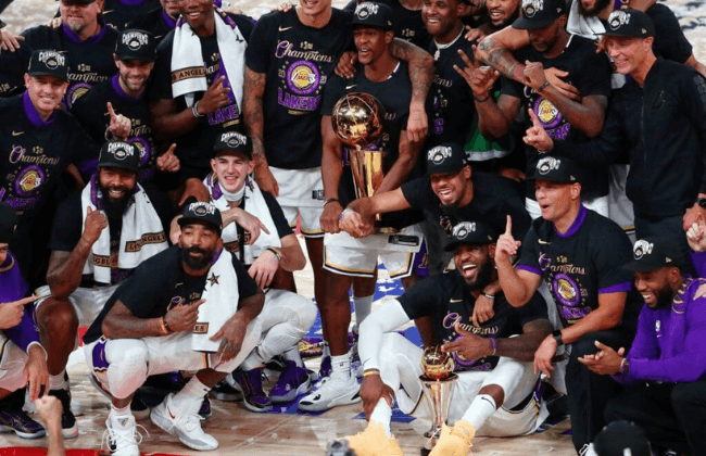 Oct 11, 2020; Lake Buena Vista, Florida, USA; The Los Angeles Lakers pose for a photo after their win over the Miami Heat after game six of the 2020 NBA Finals at AdventHealth Arena. The Los Angeles Lakers won 106-93 to win the series. Mandatory Credit: Kim Klement-USA TODAY Sports