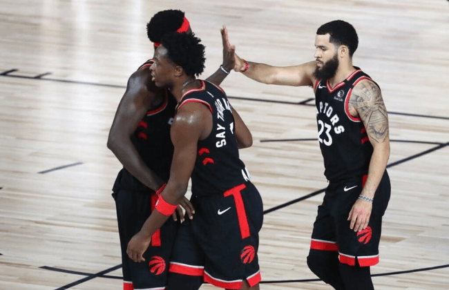 Sep 5, 2020; Lake Buena Vista, Florida, USA; Toronto Raptors guard Fred VanVleet (23) celebrates with forward Pascal Siakam (left) and forward OG Anunoby (middle) after defeating the Boston Celtics game four in the second round of the 2020 NBA Playoffs at ESPN Wide World of Sports Complex. Mandatory Credit: Kim Klement-USA TODAY Sports