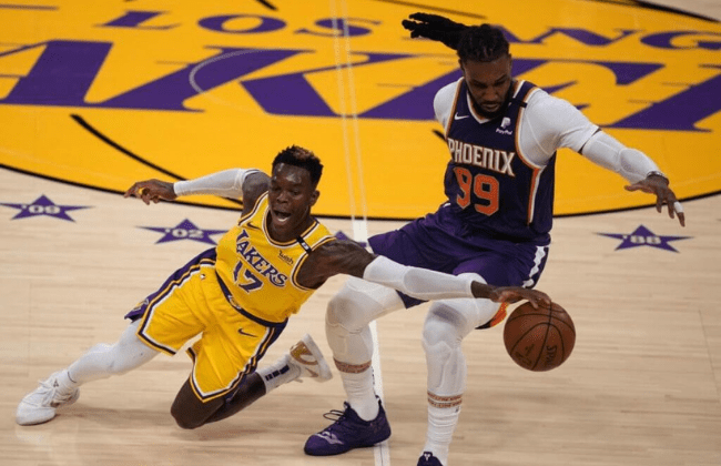 Jun 3, 2021; Los Angeles, California, USA; Los Angeles Lakers guard Dennis Schroder (17) and Phoenix Suns forward Jae Crowder (99) battle for the ball in the second half during game six in the first round of the 2021 NBA Playoffs at Staples Center. Mandatory Credit: Kirby Lee-USA TODAY Sports