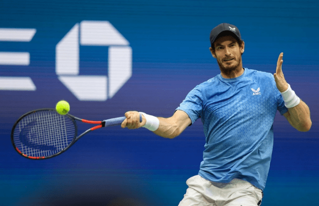 NEW YORK, NEW YORK - AUGUST 30: Andy Murray of United Kingdom returns a shot against Stefanos Tsitsipas of Greece during their men's singles first round match on Day One of the 2021 US Open at the Billie Jean King National Tennis Center on August 30, 2021 in the Flushing neighborhood of the Queens borough of New York City. (Photo by Elsa/Getty Images)