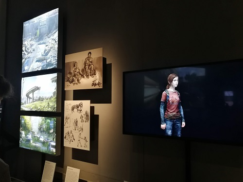 Monitors and illustrated boards display scenes, character design and scenery from The Last of Us