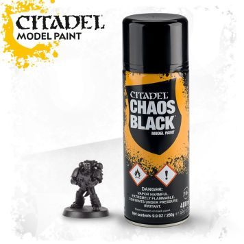 Chaos Black Primer by Games Workshop next to a based Space Marine model.