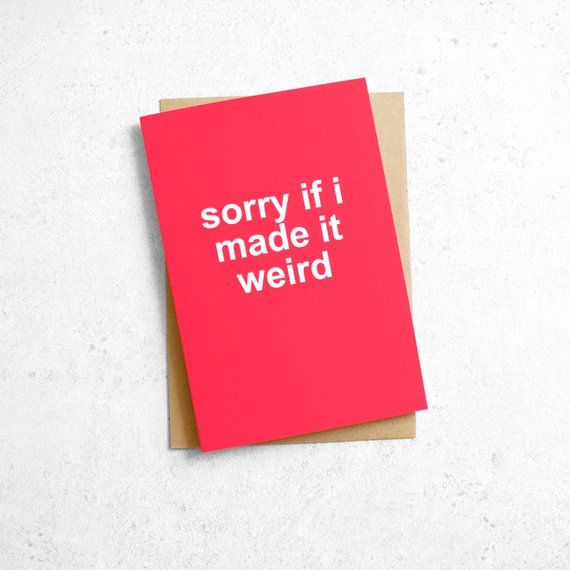 "An image of a pink card reading, ""sorry if i made it weird"" in white letters."