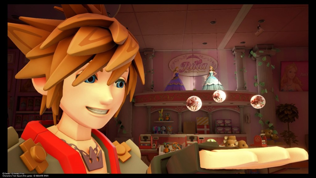 Sora takes a selfie in front of three pink disco balls in the toy store in Toy Box. From another angle, the disco balls form a Lucky Emblem. Kingdom Hearts III, Square Enix, 2019.