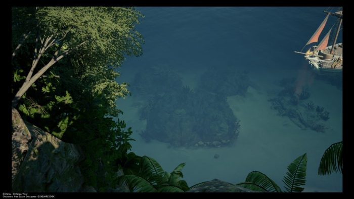 A top-down shot of the Caribbean world in Kingdom Hearts III. The camera is at the top of a hill, looking down through foliage at the clear blue water. A ship pokes into frame from the right. Kingdom Hearts III, Square Enix, 2019