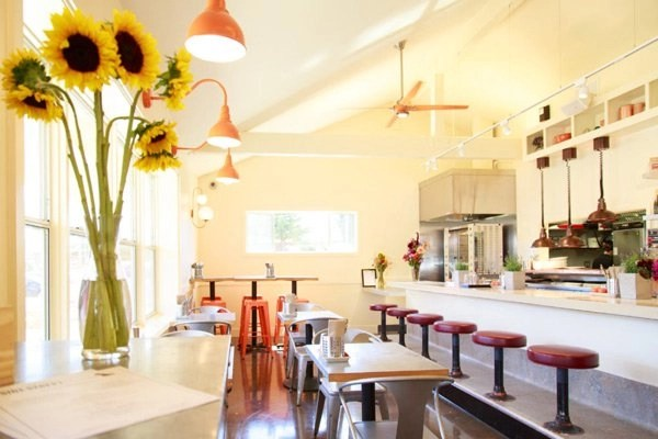 Dining room with barstools and counter.