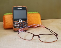 Orange case phone and glasses cell etiquette
