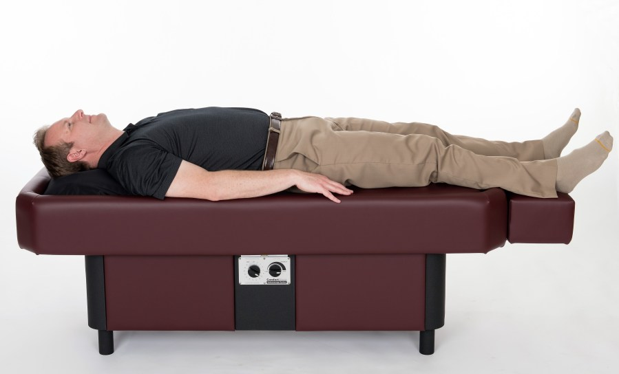 man laying on ComfortWave hydromassage table