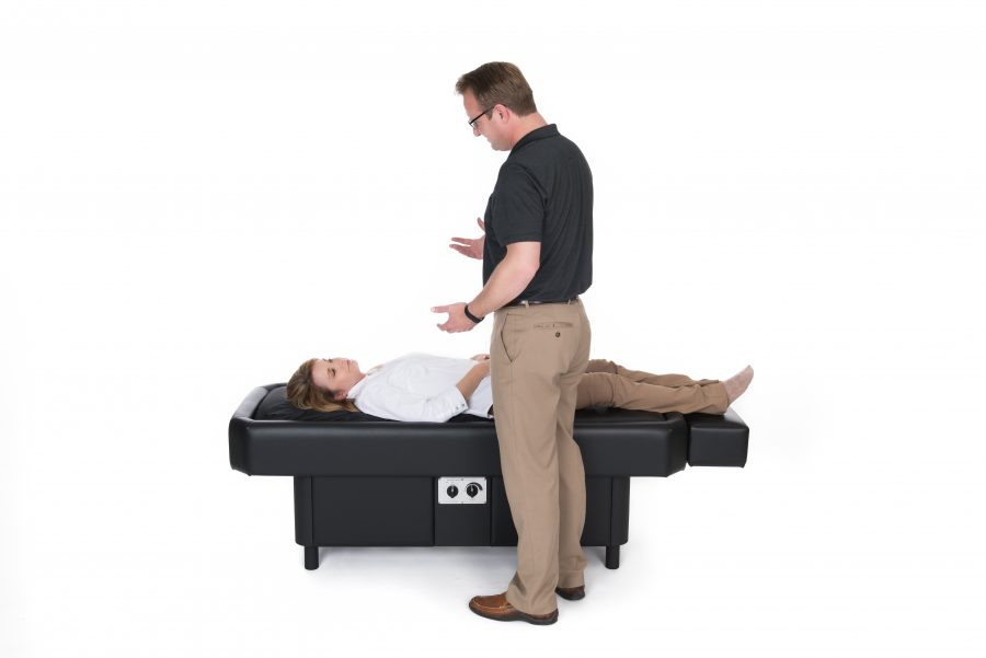 doctor explaining hydromassage therapy