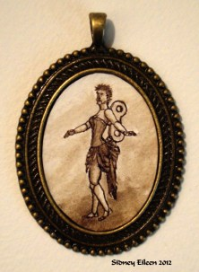 Brown Clockwork Doll in Large Brass Pendant, by Sidney Eileen, Medium: ink on watercolor paper