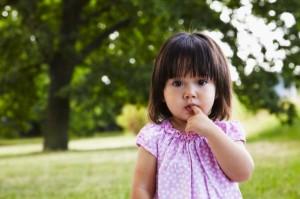 Portrait of girl (2-3) in park