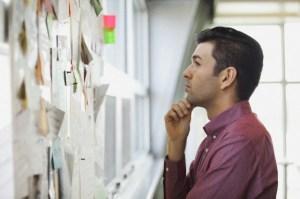 Businessman reading bulletin board