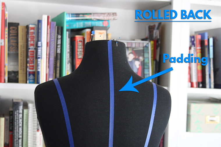 To mimic a rolled back on a dress form, add padding on the back between the princess seams.