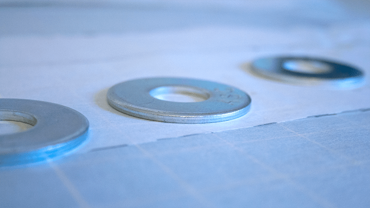 When tracing sewing patterns, pattern weights (these are washers from a hardware store) keep tracing paper and pattern pieces from shifting.