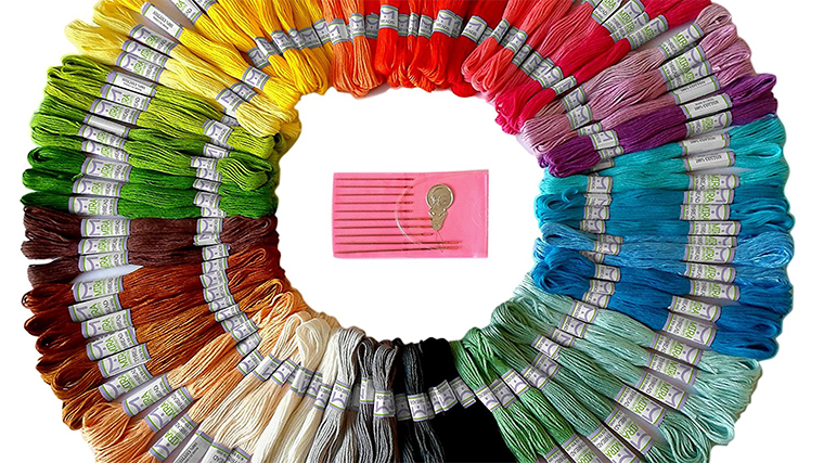 Add visible mending or embroidery in the colors of the rainbow.