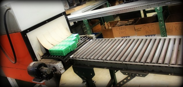 Bullets are packed in green boxes for consumers and then sorted by part number into bins to fill orders.