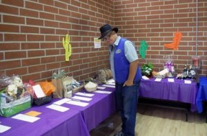 Marc Van Cleave checking out the Silent Auction items on display