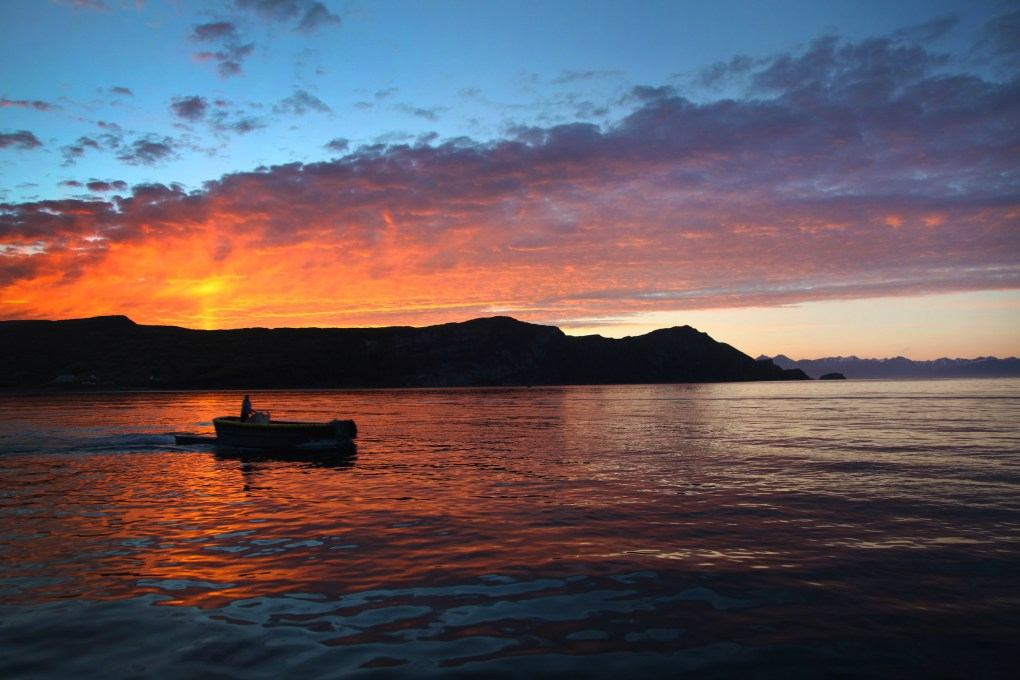 sunset in alaska with boat