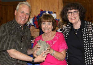 Photo by Ed Nahin: Ted Schade, ICARE President, Pat Olsen, 50/50 drawing winner for $1,500, and Patricia Nahin, Bishop Noon Rotary President