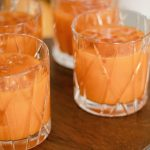 Harry Potter Pumpkin Juice in clear classes on a cake stand