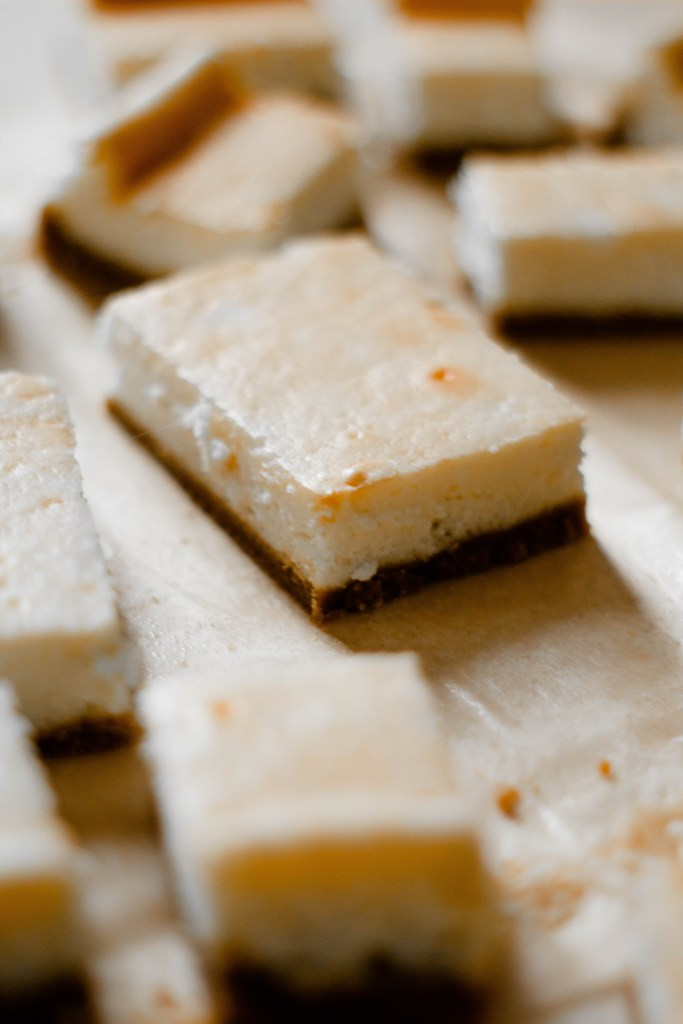Gluten Free Recipe for Cheesecake Bars on parchment paper