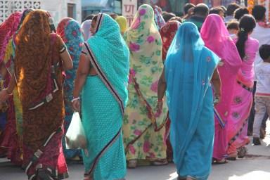group of women walking through the bazaar in Pushkar
