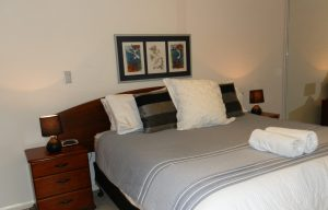 king sized bed in the master bedroom short term rentals in Perth